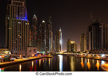 Dubai Marina at night, United Arab Emirates - This is an...