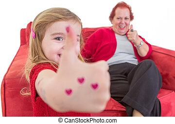 Cute little girl giving a thumbs up gesture - Cute little...