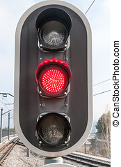 red traffic light - Detail of a red traffic light rail