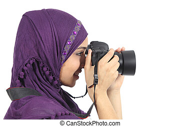 Arab woman photographer holding a dslr camera isolated on a...