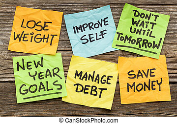 New Year goals or resolutions - handwriting on sticky notes...