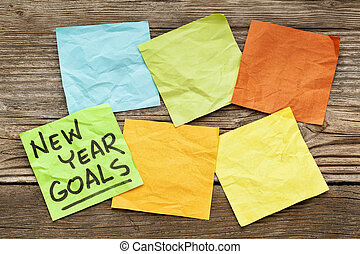 New Year goals note - New Year goals - handwriting on a...