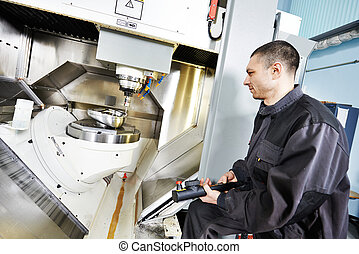 worker operating metal machining center - mechanical...