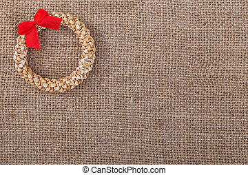 Decorative wreath straw sacking symbol of New Year and Christmas.