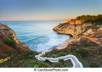 Beautiful seascape bay with serpentine steps Portugal,...