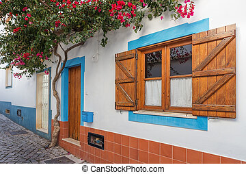 Traditional old Portuguese street with decorative window...