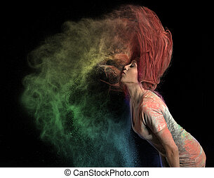 Girl Flinging Red Hair - Redhead girl with colored powder...