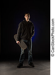 Young Adult Holding Skateboard