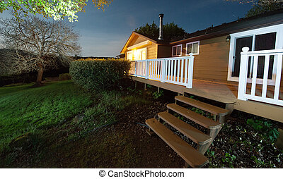 Country House at Night - A home with a deck in the country...