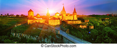 Fortress in the town of Kamenetz-Podolsk - The first rays of...