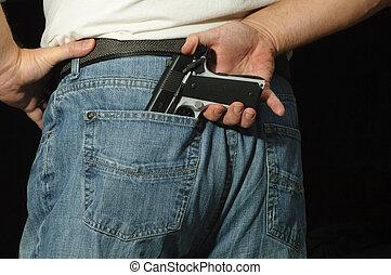 Gun in Jeans - Man conceals gun