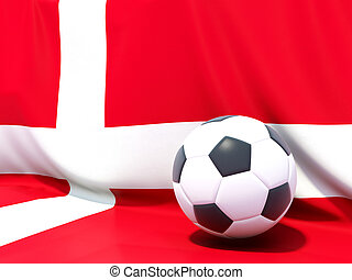Flag of denmark with football in front of it