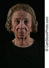 Elderly Old Woman on Black Background - Unhappy Elderly Old...