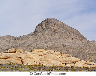 Cone making - Erosion shaping the mountain into a cone.