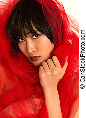 Red tulle - Closeup on the face of a beautiful young...