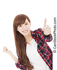 Beautiful smiling young woman standing with thumb up