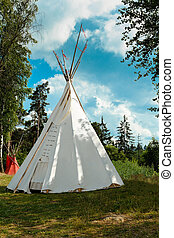 indian tepee against blue sky - A tipi also tepee and teepee...