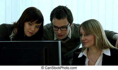 The successful transaction - Three people close look at the...