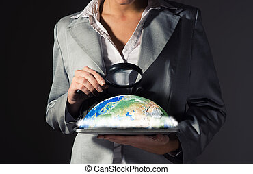 business woman looking at the planet - business woman with a...
