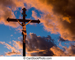 Crucified Christ over red evening sky - Easter etc.