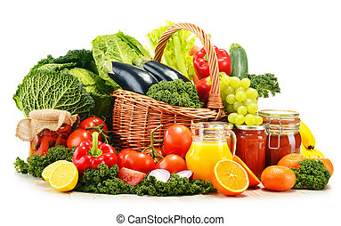 Wicker basket with assorted organic vegetables and fruits...