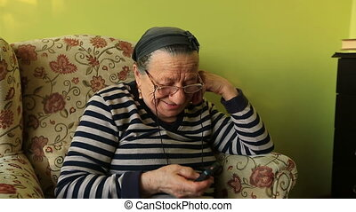 talking phone - elderly woman talking on the mobile phone at...