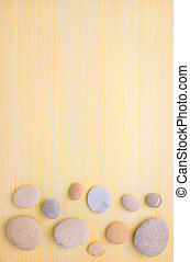 pebbles  frame on wooden  background