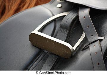 Close up of black saddle on horse back - Close up of black...