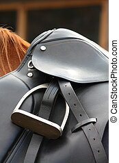 Close up of black saddle on horse back - Close up of black...