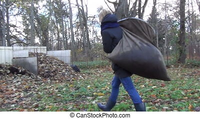 tired worker girl compost - tired worker gardener girl carry...