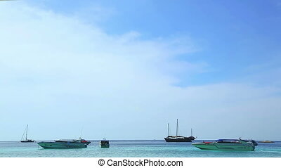 Boats floating in the calm sea.