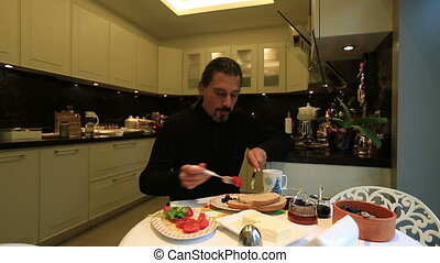 breakfast - attractive man doing breakfast at home
