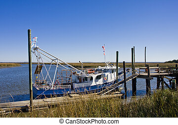 Shrimp Boat at Marsh Dock - A blue and white shrimp boat at...