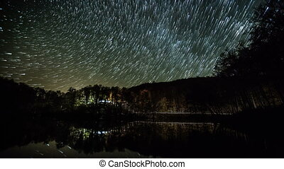 star trials - milky way moving across the night sky and...