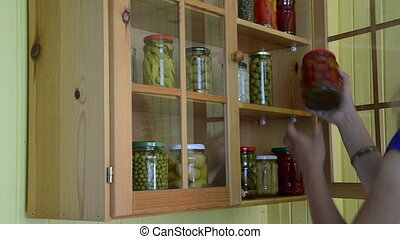 Woman preserve cucumber - Girl woman take glass jar pot with...