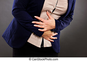 Closeup of woman with stomach issues