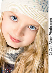 face close-up - Portrait of a pretty ten years girl in warm...