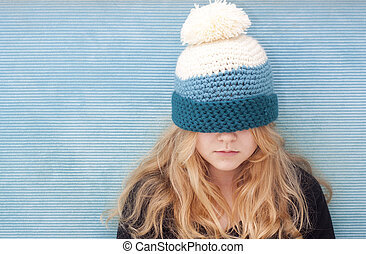 Girl with hat pulled over her eyes - Teenager with hat...