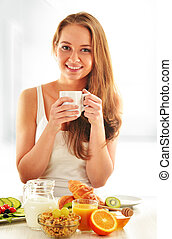 Young woman having breakfast Balanced diet