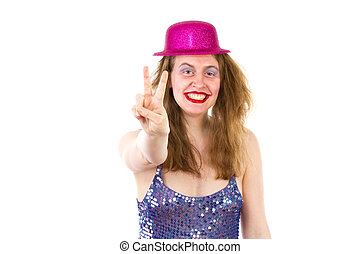 Young woman at party showing v sign