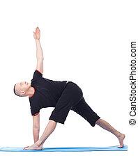 Yoga Flexible man practising in studio, isolated on white
