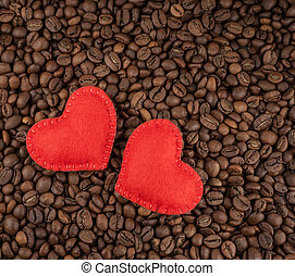 Red hearts on coffee beans background.