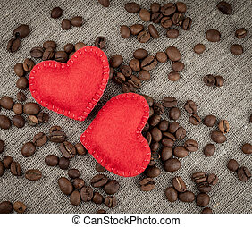 Red hearts on coffee beans background