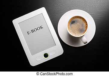 Reader and coffe - E-book reader and white coffee cup on...
