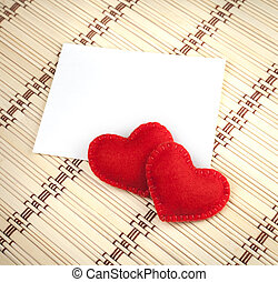 Red hearts and label on bamboo mat.