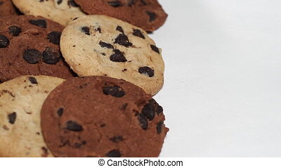 Mixed coockies on white turning close up