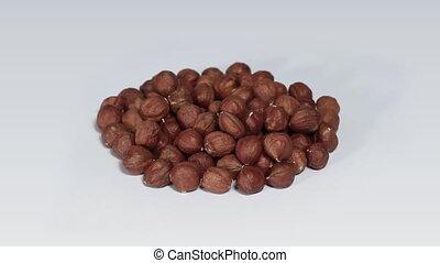 Huzelnuts on white turning close up