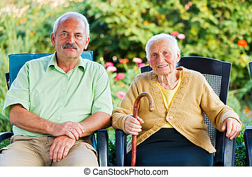 Mother and Son Smiling - Happy elderly woman in a nursing...