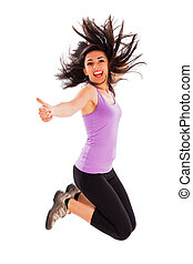 Success - Pretty fit girl showing like sign while jumping...