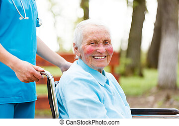 Smiling Elderly Lady in Wheelchair